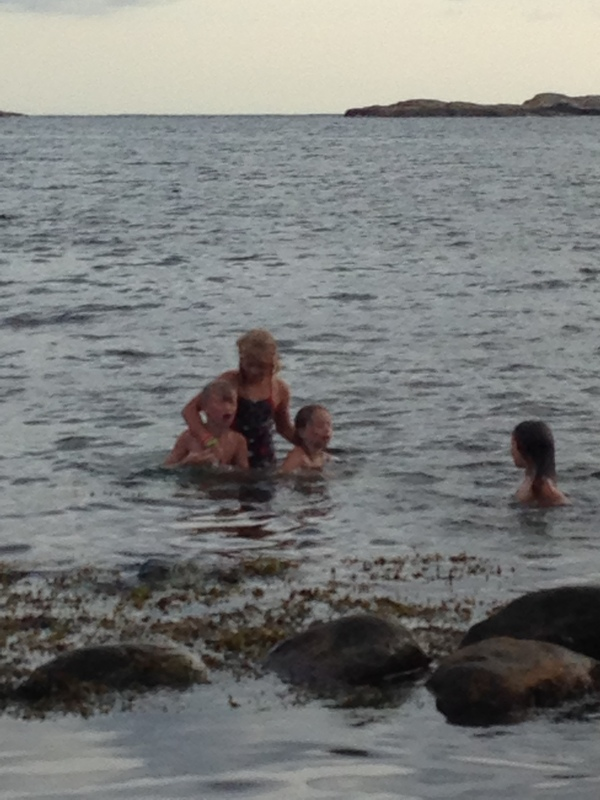 Swimming (here, with her Swedish cousins in Rosso) is the other place besides planes where she makes strong, yet fleeting friendships.